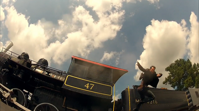 File:Miles jumps off the train..png