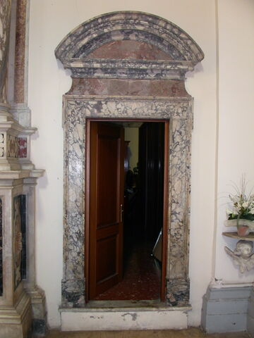 File:2011 Ambrogio, left transept doorway to right.jpg