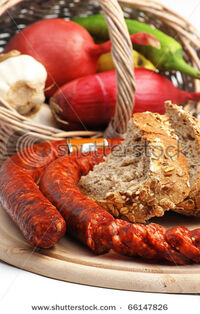Stock-photo-traditional-romanian-sausage-with-soem-of-its-ingredients-66147826