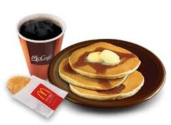 McDonald's Hotcakes McCafe drink and Hash Browns