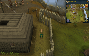 Compass clue Edgeville east of building with potter's wheel in Barbarian Village