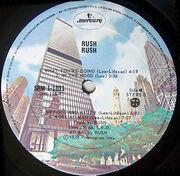 Rush, Mercury SRM-1-1011 Canadabuildingsside2