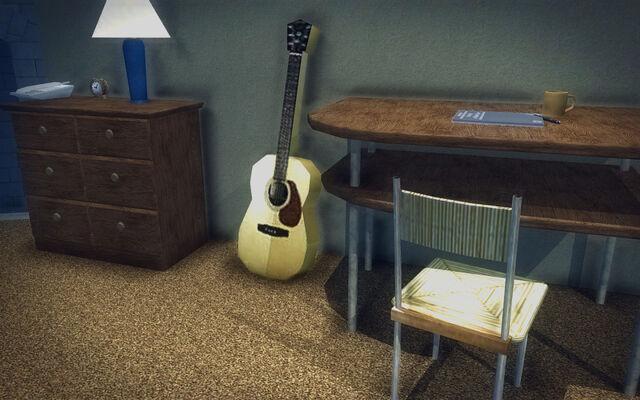 File:Red Light Loft - Classy - bedside table, guitar, and desk.jpg