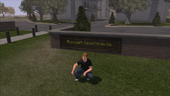 Sunset Apartments sign
