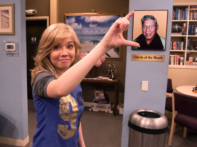 File:Jennette posing with a picture of her grandpa.jpg