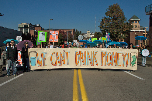 File:We Can't Drink Money.jpg