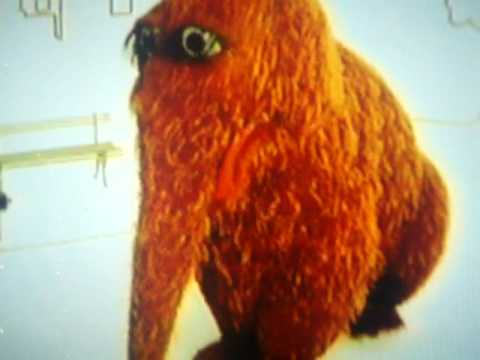File:Snuffy from ElmoPalooza closing credits.jpg