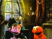 The Count and Elmo laughing together