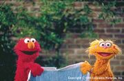 Elmo and zoe with blanket