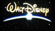 Walt Disney in gold in outer space