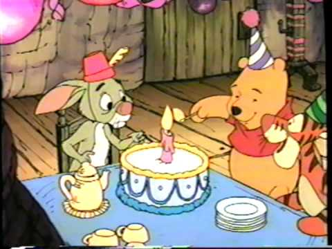 File:Pooh lighting a candlestick on the cake.jpg