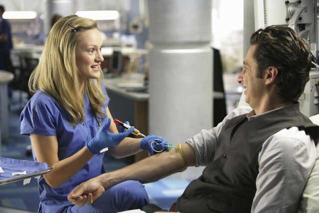 File:9x5 Lucy taking blood sample from JD 2.jpg