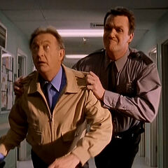 As a security guard, Janitor tackles Dr. Kelso. <span style=