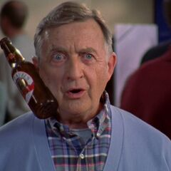 Dr. Kelso uses surgical glue and attaches a beer bottle to his face