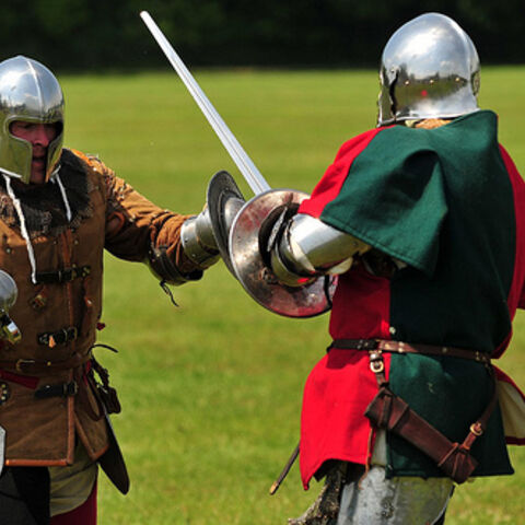 Two Light Infantry sparring with swords