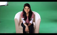 Selena sitting in a chair