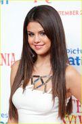 Selena Gomez wearing a white dress