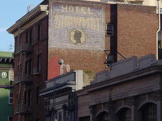 Fading sign on Coast Hotel