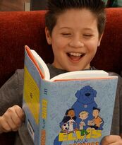 Davis-cleveland-laughing-and-reading-a-book