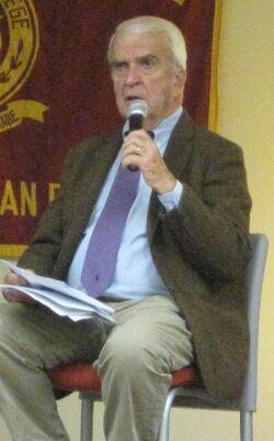 Ed Noonan seated speaking