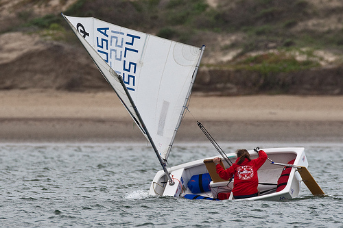 File:Energetic skilled young girl, this youngster from Morro Bay Yacht Club Junior Lifeguard Sailboat Race in Morro Bay, CA., demonstrates sailing skills in avoiding a capsize by yanking up the centerboard and heaving to.jpg