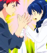 Sōma claps Megumi's hands (anime)