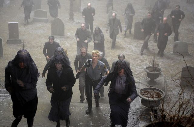 File:Cybil & others heading for the church.jpg