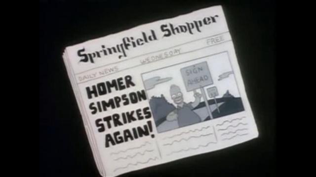 File:HomerNewspaperSign.png