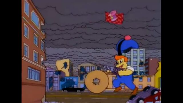 File:Lard Lad Uses His Donut And The KBBL Antennae To Destroy The Road.jpg