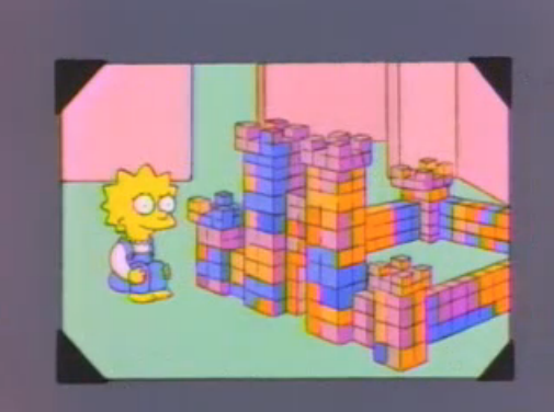 File:Lisa built a castle in a photo in And Maggie Makes Three.png