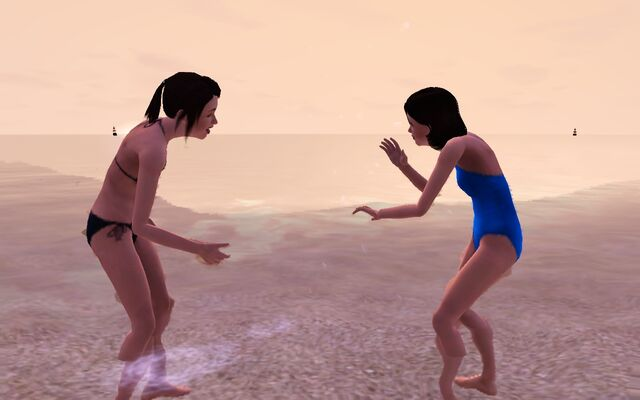 File:Redfield twins playing in the beach.jpg