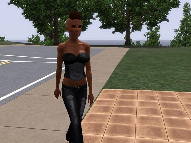 File:Kimmy Knott walking in front of New Glam household.jpg