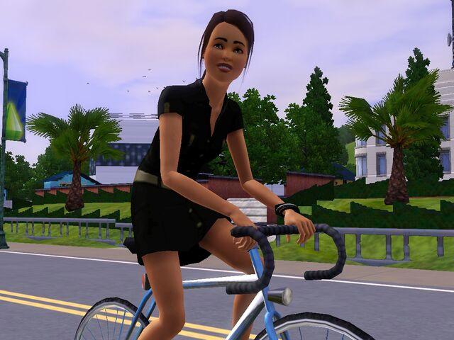 File:Leona on bike.jpg