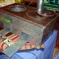 Metal Rocket stove displayed by <a href=