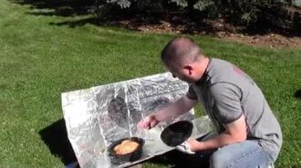 Using a solar oven to cook a chicken