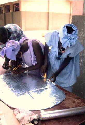 File:Tilo Tabiro constructing cookers 2008.jpg