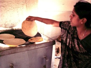 File:Barli Institute student making chapatis in the Scheffler kitchen.jpg