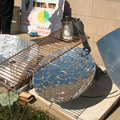 Close-up of Heather D.'s mirror-mosaic parabolic cooker.