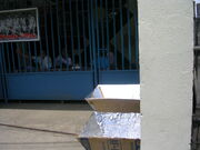 Two solar cookers at the Kong Hua School
