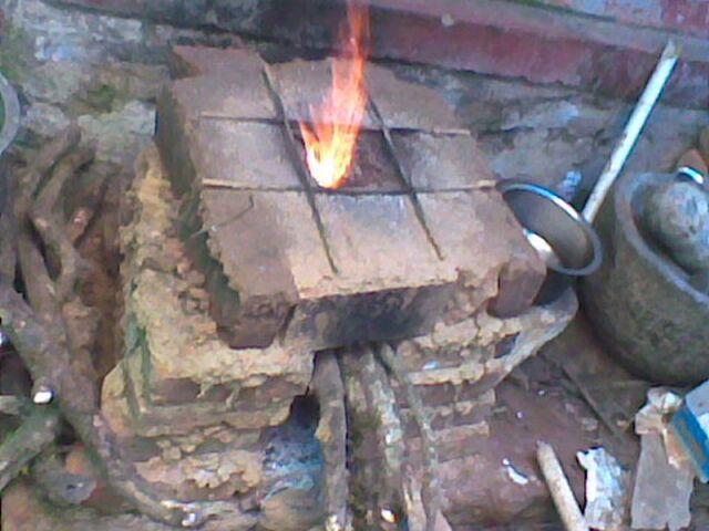 File:Wood burning stove .jpg