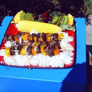 Shish Kabobs and Corn with a garnish of Fruit