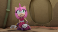 Amy sitting in a tent.png