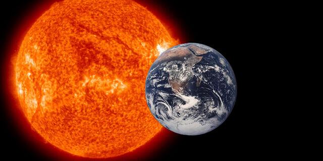 File:Sun and earth.jpg