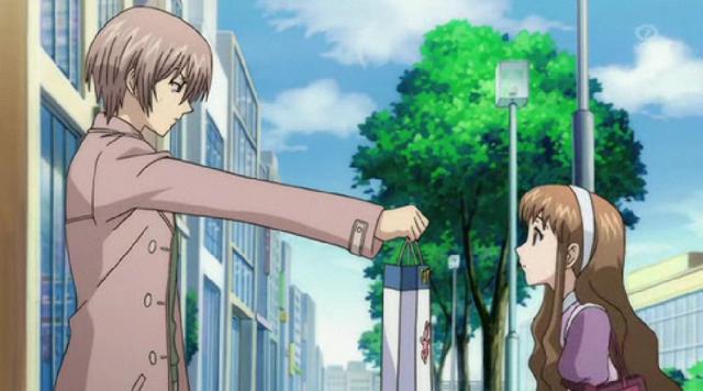 File:Yashiro handing over something to Megumi.png