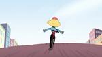 S2E5 Rear view of Star riding a bike