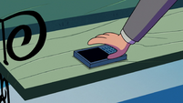 S2E27 Marco sets his phone on the bench