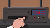 S2E4 Dojo Sensei presses VCR eject button