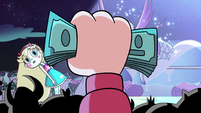 S2E33 Marco Diaz holding 650 dollars in his hand
