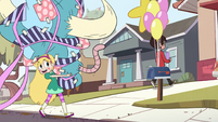 S2E29 Star Butterfly carrying a large present