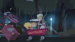 S3E1 Star and Moon riding a little red wagon